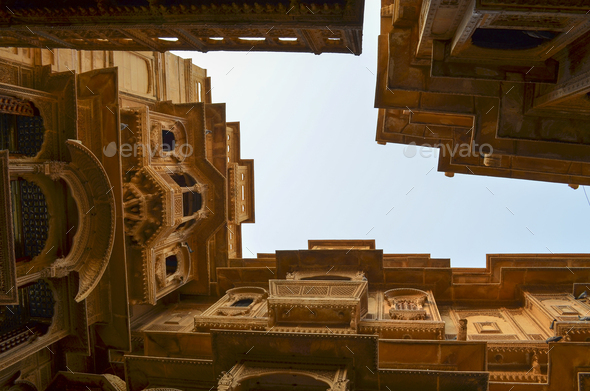 View up from the ground inside a historic fortified building in Jaisalmer. Traditional architecture, - Stock Photo - Images