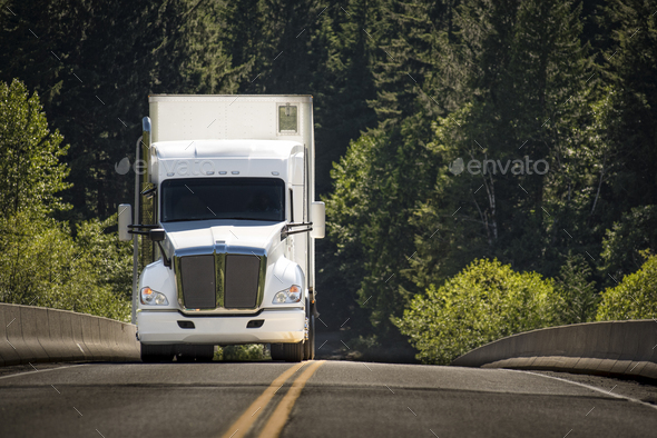 A commercial truck on the road. - Stock Photo - Images