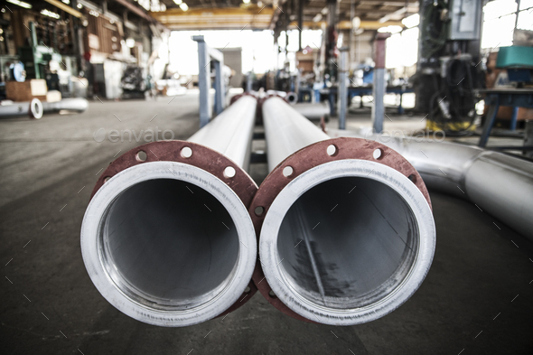 Aluminum pipes manufactured in a sheet metal factory. - Stock Photo - Images