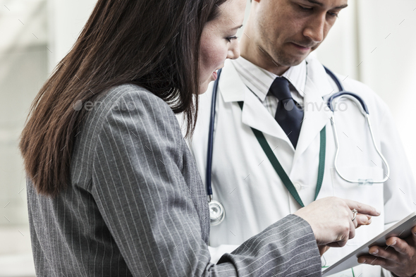 Man and woman doctors meeting to discuss a problem - Stock Photo - Images