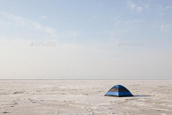 A blue tent on Bonneville Salt Flats at dusk. - Stock Photo - Images