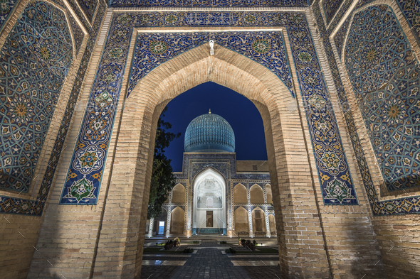 Archway inlaid with vibrant mosaic tile patterns, The Registan, a historic 15th century Madrasa - Stock Photo - Images