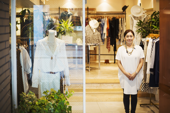 Woman working in a fashion boutique in Tokyo, Japan. - Stock Photo - Images