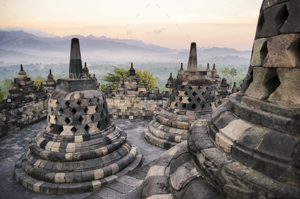 Borobudur temple, a 9th century Buddhist temple with terraces and stupa with latticed exterior, bell - Stock Photo - Images