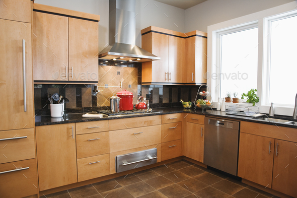 A fitted kitchen interior in a home. - Stock Photo - Images