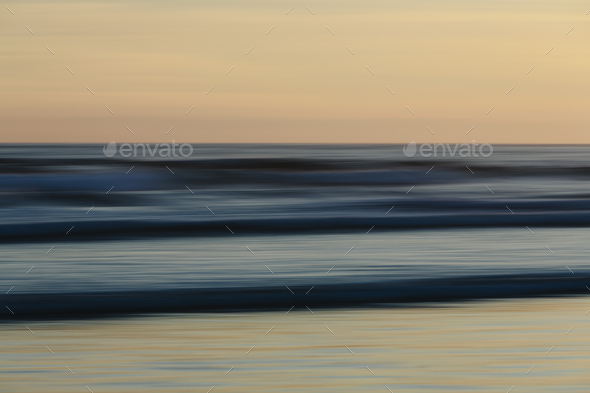 View from the beach over the ocean at sunset, long exposure - Stock Photo - Images
