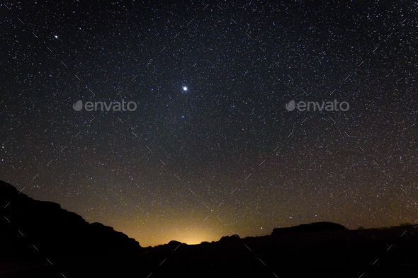 Stars across the sky in the Wadi Rum desert wilderness in southern Jordan at night. - Stock Photo - Images