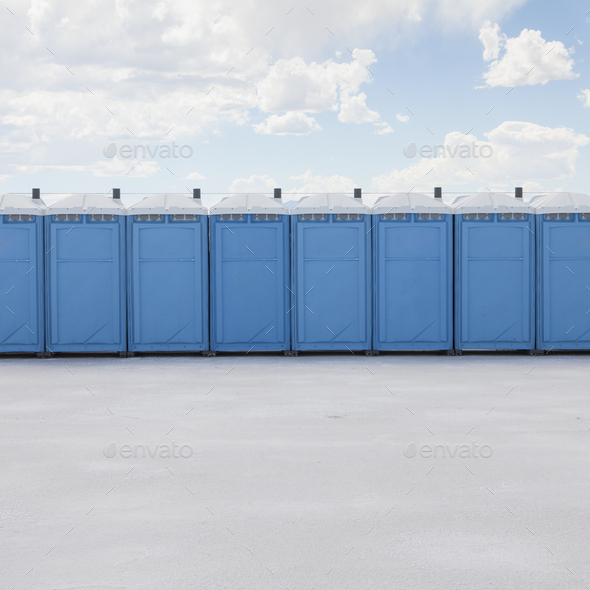 Row of portable toilets on salt flats, during Speed Week - Stock Photo - Images