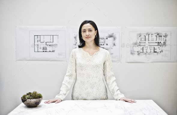 Hispanic woman in an architect's office. - Stock Photo - Images