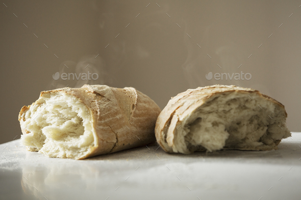 Close up of two freshly baked loaves of bread. - Stock Photo - Images
