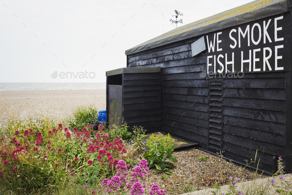 Exterior view of brown wooden fish shop on Suffolk coast. - Stock Photo - Images