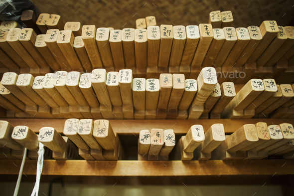 Shelves of wooden moulds for specialist treats, sweets called wagashi. - Stock Photo - Images