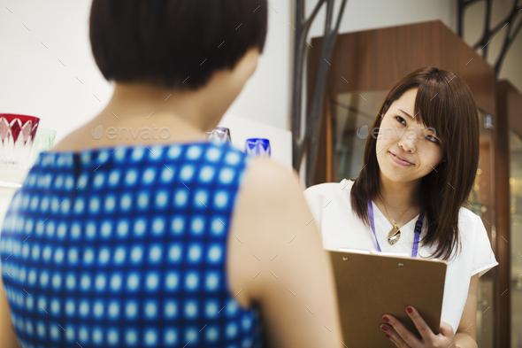 Saleswoman in a shop selling Edo Kiriko cut glass in Tokyo, Japan. - Stock Photo - Images