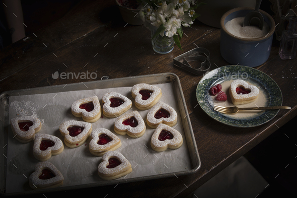 Valentine's Day baking, high angle view of a baking tray with heart shaped biscuits. - Stock Photo - Images