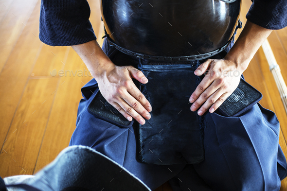 Close up of Kendo fighter kneeling on floor, hands on lap. - Stock Photo - Images