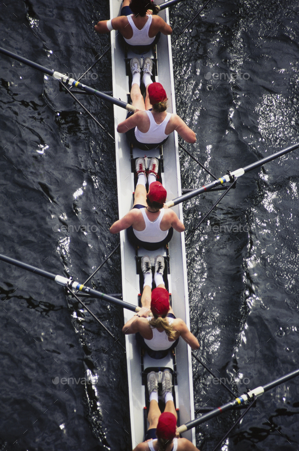 Overhead view of female crew racers rowing a sports racing shell.  boat - Stock Photo - Images