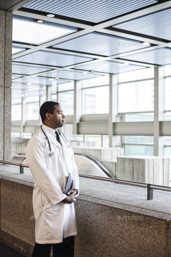Black man doctor in lab coat with a stethescope. - Stock Photo - Images