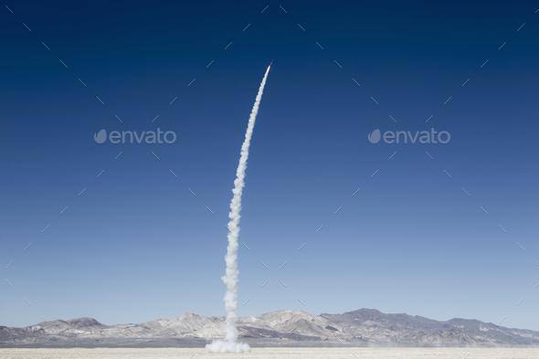 Rocket shooting into vast, desert sky, Black Rock Desert, Nevada - Stock Photo - Images