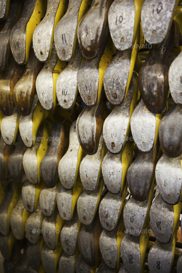Close up of various metal shoe forms, shoemaker's lasts, in a shoemaker's workshop. - Stock Photo - Images
