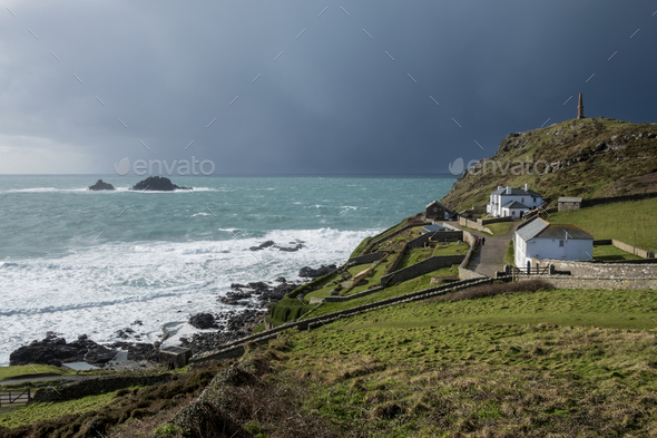 Cot Valley, St Just, West Cornwall coastline. View of cottages overlooking the coast and the Brisons - Stock Photo - Images