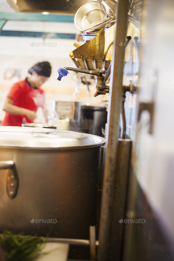 The ramen noodle shop. A chef working in a kitchen. - Stock Photo - Images