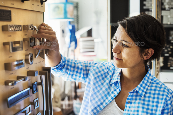 Woman looking at merchandise in an interior design store. - Stock Photo - Images