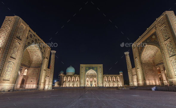 Registan Square at night, with imposing Madrasa buildings, Ulugh Beg Madrasah, Sher-Dor Madrasah and - Stock Photo - Images