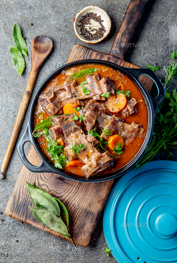 Beef ribs Bourguignon. Beef ribs stewed with carrot, onion in red wine. France dish. Top view - Stock Photo - Images