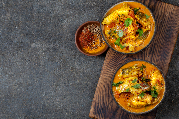Indian Fish Curry, top view, gray background - Stock Photo - Images