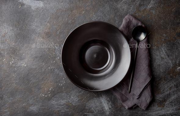 Black plate isolated on black background - Stock Photo - Images