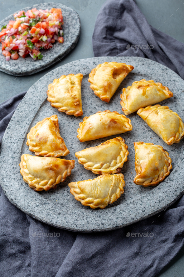 empanadas with ground meat on gray plate - Stock Photo - Images