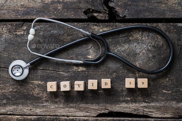 Covid 19 sign and medical stethoscope - Stock Photo - Images