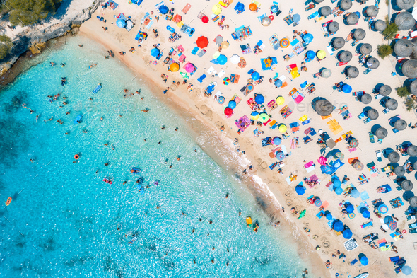 Aerial view of sandy beach with colorful umbrellas - Stock Photo - Images