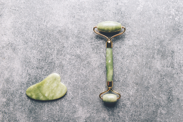 Jade face roller and Gua sha stone - Stock Photo - Images