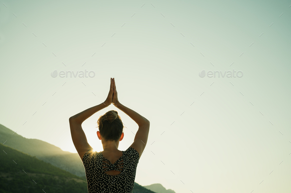 Young woman doing yoga workout at sunrise - Stock Photo - Images
