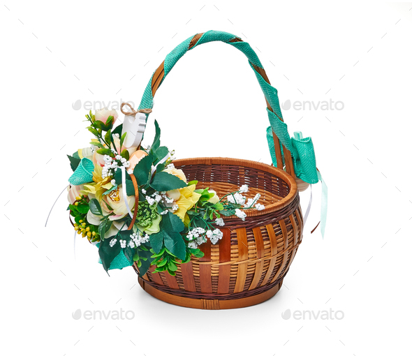 Easter basket from a flower arrangement on white background - Stock Photo - Images