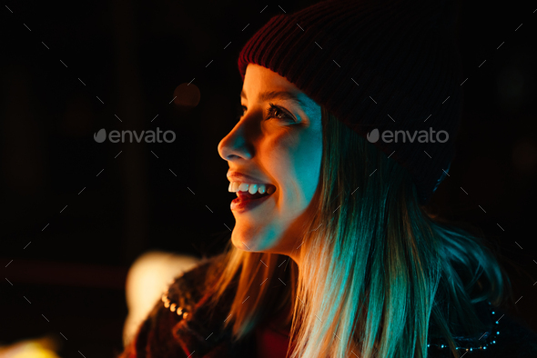 Photo of beautiful joyful woman smiling and looking aside while walking - Stock Photo - Images