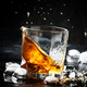 Whiskey with ice, splashes out of glass - PhotoDune Item for Sale