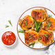 Baked chicken thighs with herbs on white plate - PhotoDune Item for Sale