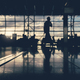 Defocused silhouettes of business people traveling on airport. - PhotoDune Item for Sale