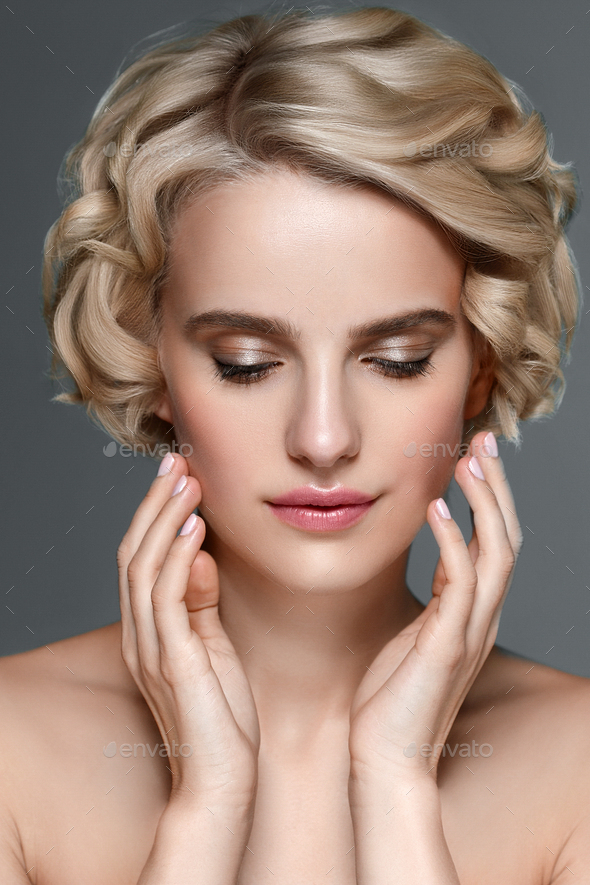 Short curly hair young  woman beauty face portrait - Stock Photo - Images