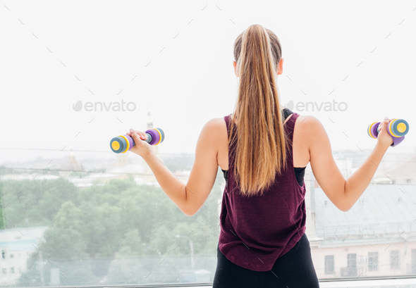 Woman stretching sport at home over brick wall - Stock Photo - Images