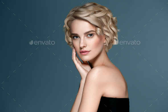 Short curly hair woman beauty face portrait - Stock Photo - Images