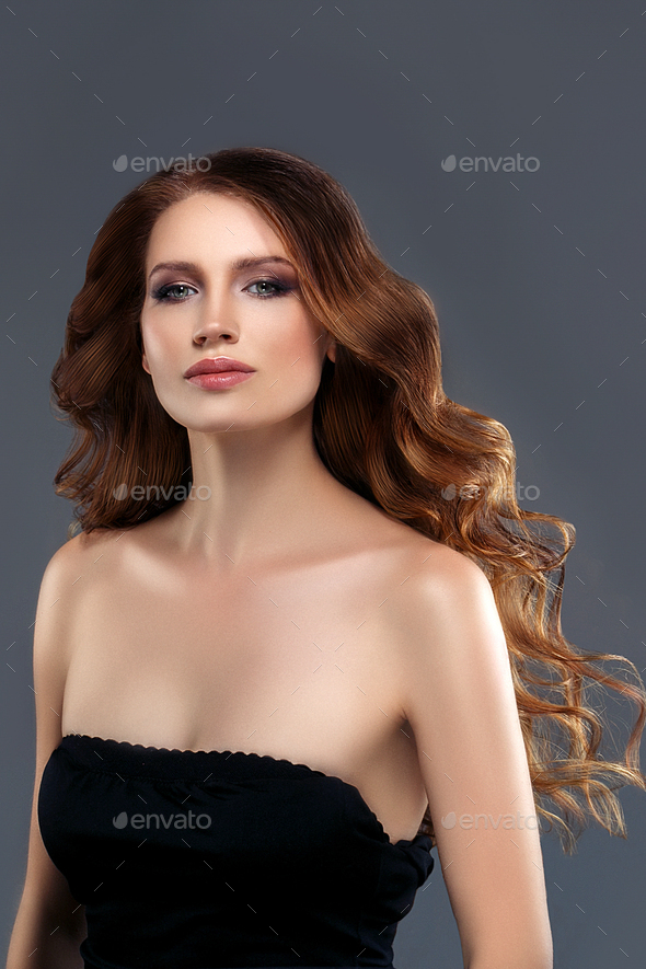 Woman perfect hair beautiful female portrait blue background. Brunette long curly hairstyle concept - Stock Photo - Images