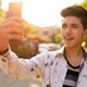 Young handsome Indian teenage boy in the streets outdoors - PhotoDune Item for Sale