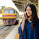 Young beautiful Asian tourist woman at the railway station - PhotoDune Item for Sale