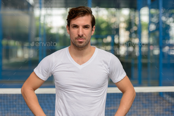 Young handsome Hispanic man at the tennis court - Stock Photo - Images