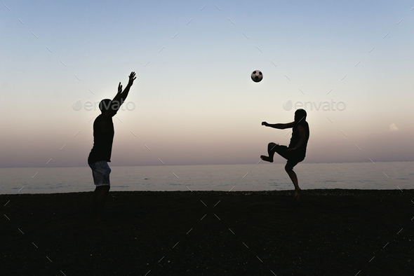 Two friends playing soccer. - Stock Photo - Images
