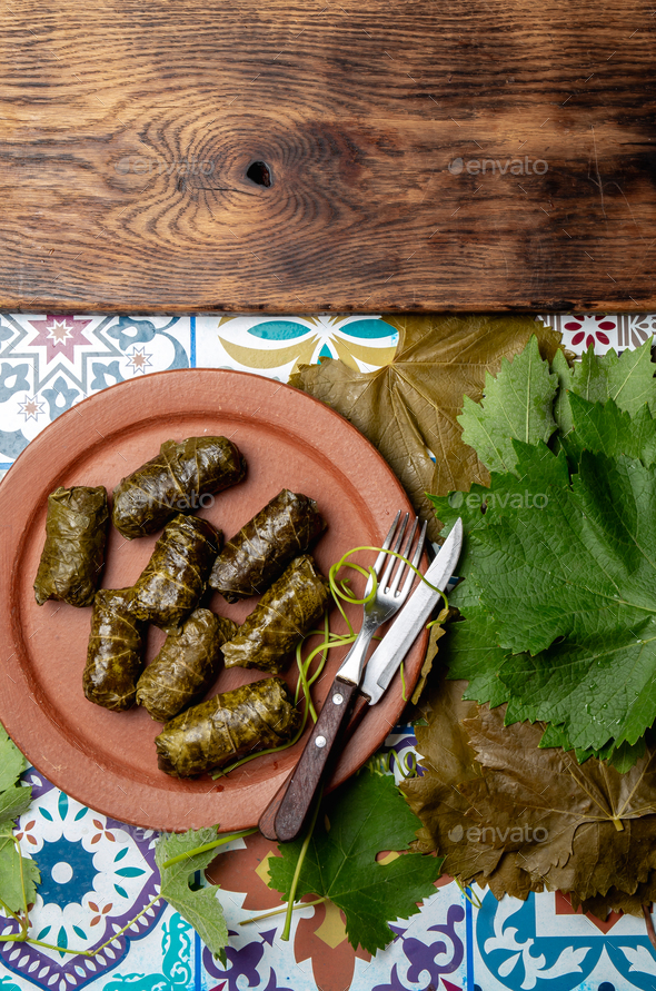 Plate of delicious stuffed grape leaves with parsley garnish. - Stock Photo - Images