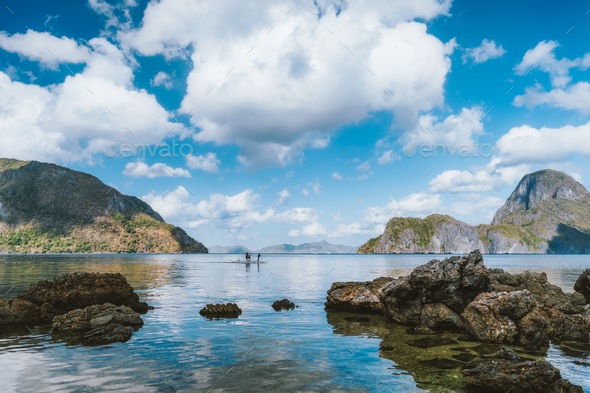 Palawan, Philippines. Seascape of El Nido bay, with white clouds, ocean reflection and Cadlao island - Stock Photo - Images